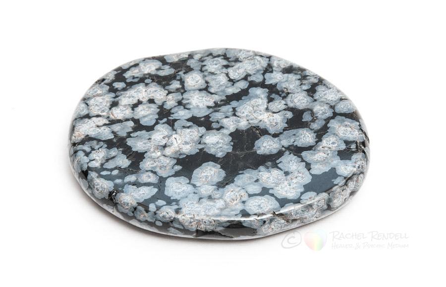 Snowflake obsidian palm stone.