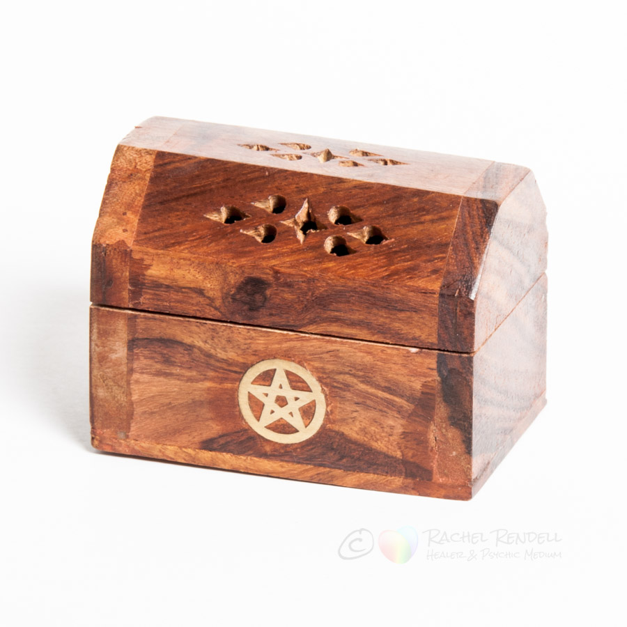 Small wooden incense burner.